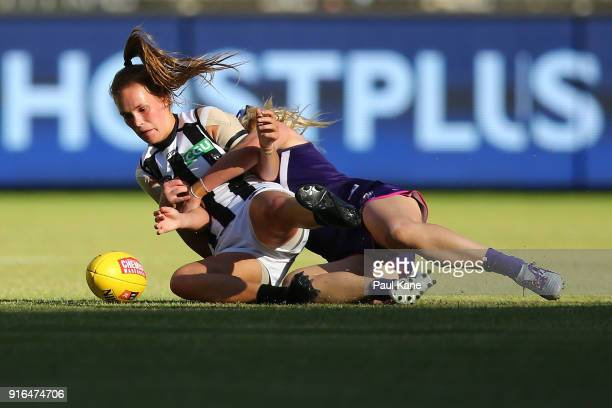 Holly Whitford of the Magpies get tackled by Hayley Miller of the Dockers during the round two AFLW match between the Fremantle Dockers and the...
