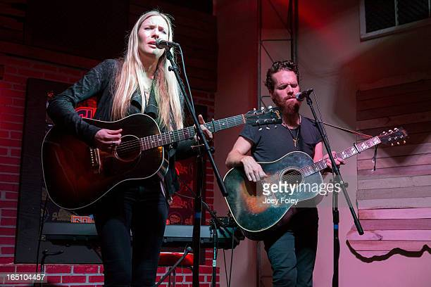 Holly Williams and Chris Coleman perform in concert at Do317 Lounge on March 29 2013 in Indianapolis Indiana