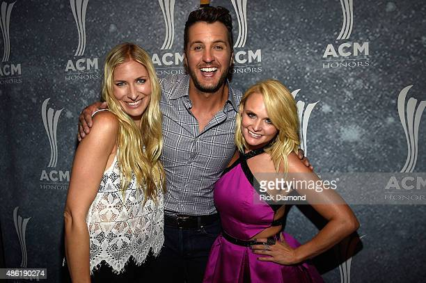 Holly Williams Luke Bryan and Miranda Lambert pose backstage during the 9th Annual ACM Honors at the Ryman Auditorium on September 1 2015 in...