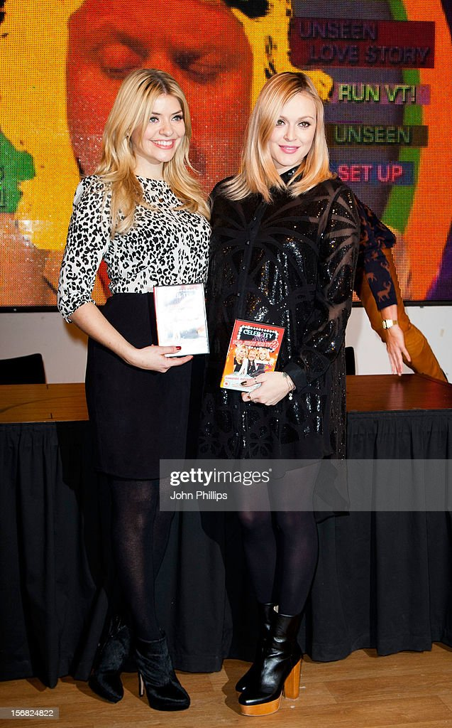 Holly Willoughby and Fearne Cotton attend the DVD signing for 'Celebrity Juice: Too Juicy For TV 2' at HMV, Oxford Street on November 22, 2012 in London, England.