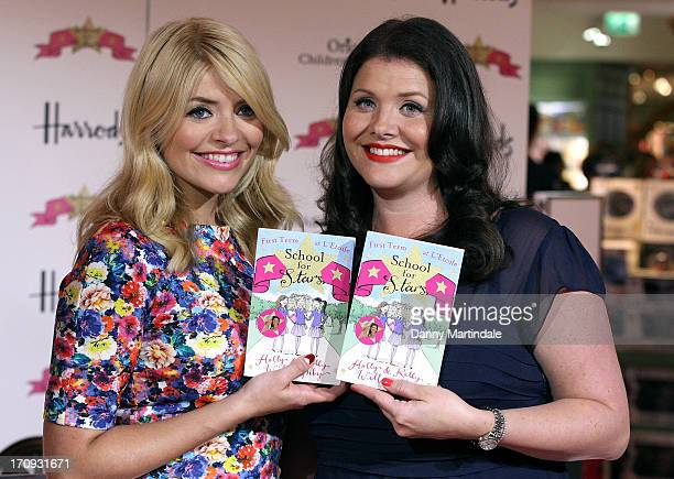 Holly Willoughby and Kelly Willoughby pose at a photocall ahead of signing copies of their book 'School for Stars' at Harrods on June 20 2013 in...