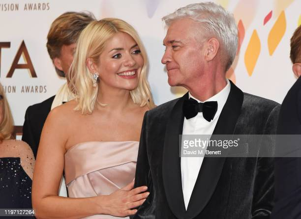 Holly Willoughby and Phillip Schofield accepting the Live Magazine Show award for This Morning pose in the winners room at the National Television...