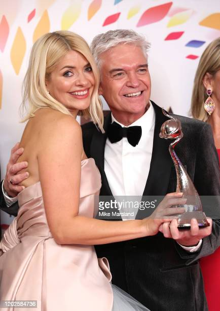 Holly Willoughby and Phillip Schofield pose with the award for Live Magazine Show for 'This Morning' in the winners room attends the National...
