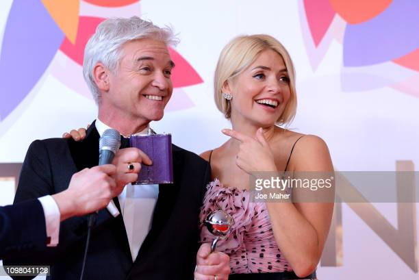 Holly Willoughby and Phillip Schofield pose with the Daytime Award in the winners room during the National Television Awards held at The O2 Arena on...
