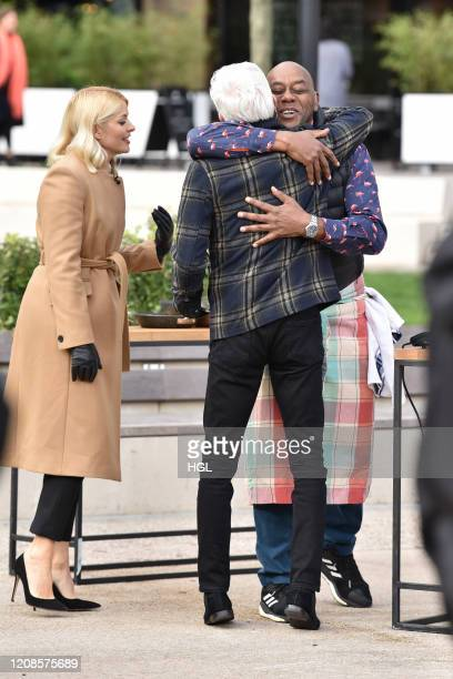 Holly Willoughby and Phillip Schofield with Ainsley Harriott attempt a world record for tossing pancakes during the This Morning show on February 25...
