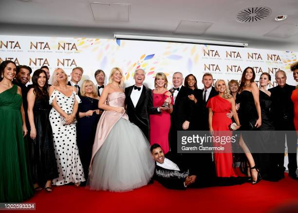 Holly Willoughby Phillip Schofield Dr Ranj Singh Ruth Langsford Eamonn Holmes Rochelle Humes Lisa Snowdon and the cast of This Morning pose in the...