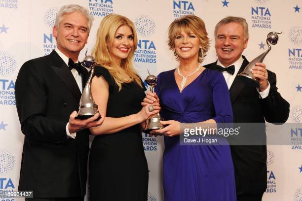 Holly Willoughby Phillip Schofield Ruth Langsford and Eamon Holmes pose with the Best Daytime TV Award for 'This Morning' in front of the winners...