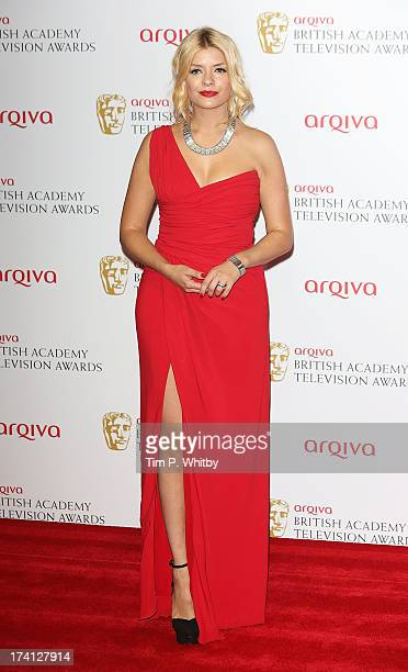 Holly Willoughby poses in the press room at the Arqiva British Academy Television Awards 2013 at the Royal Festival Hall on May 12 2013 in London...