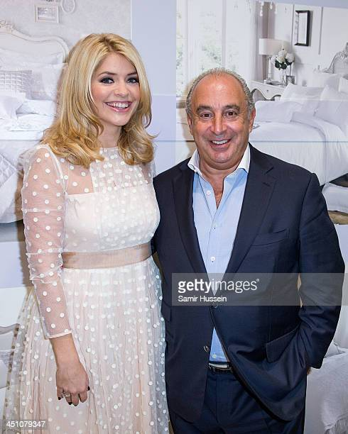 Holly Willoughby poses with Sir Philip Green as she launches her bedding collection at BHS Oxford Street on November 21 2013 in London England