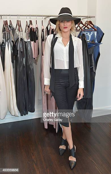 Holly Wolf attends Saudi Designer Nora Al Shaikh Unveils Her Coveted Eveningwear Collection At Decades LA at Decades on August 8 2014 in Los Angeles...