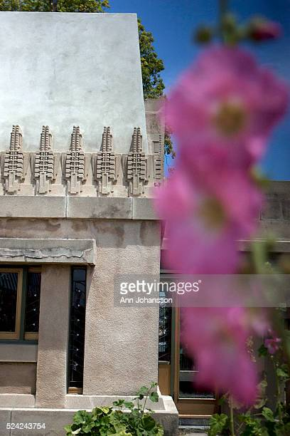 Hollyhock motifs line the Hollyhock House by architect Frank Lloyd Wright in Los Angeles June 4 2011 A Hollyhock flower blooms in the foreground The...