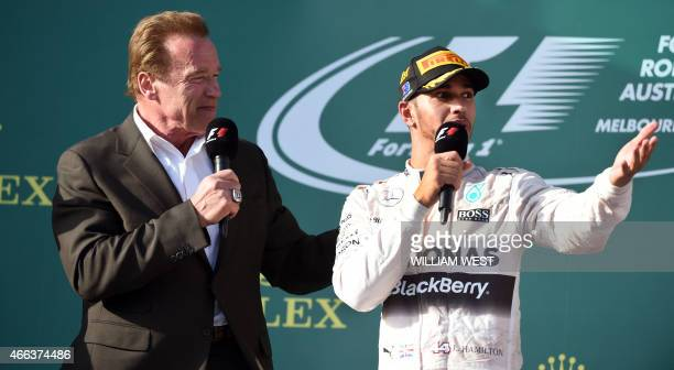 Hollywood actor Arnold Schwarzenegger interviews Mercedes AMG Petronas F1 Team's British driver Lewis Hamilton after Hamilton won the Formula One...