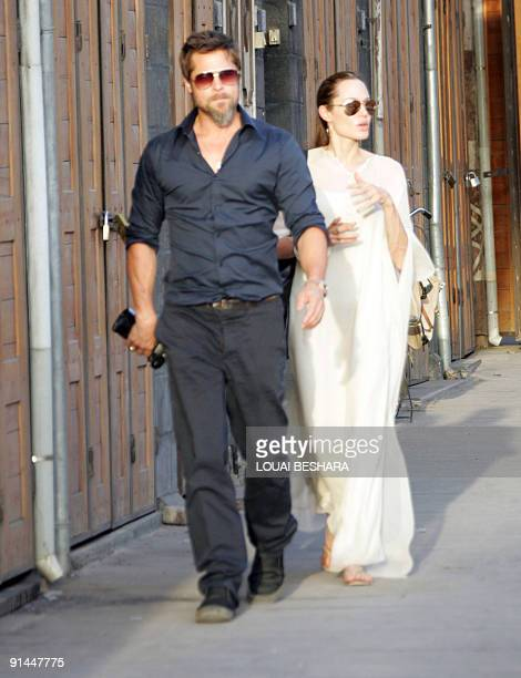 Hollywood actor Brad Pitt walks with his wife actress Angelina Jolie in the Damascus Souk or market during a brief visit to Syria on October 2 2009...