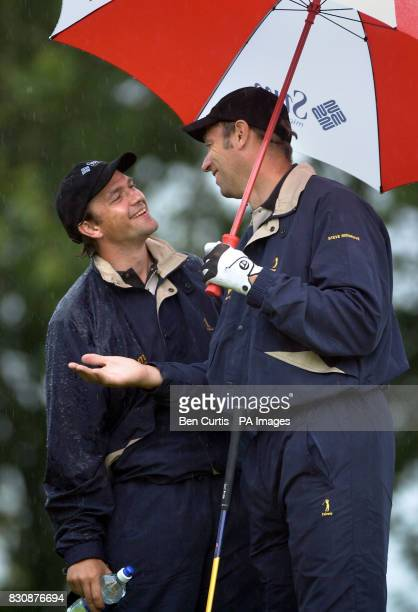 Hollywood actor Dougray Scott jokes about the torrential rain at the Gleneagles golf course as he and fivetimes Olympic Gold rowing champion Steve...