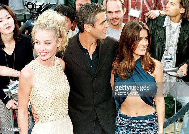 Hollywood actor George Clooney poses with his friend Celine and South American actress Salma Hayek as they arrive at Mann's Village and Bruin...