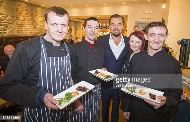 Hollywood actor Leonardo DiCaprio poses with formerly homeless staff Colin Childs Joe Hart Biffy Mackay and Sonny Murray helped prepare lunch for...