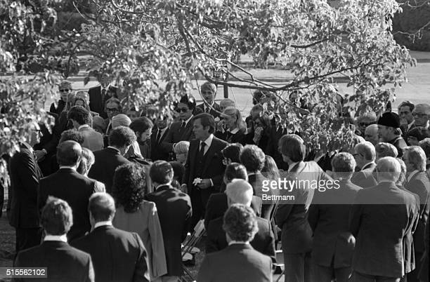 Hollywood: Actor Robert Wagner stands amid friends holding a flower from his wife's casket at graveside ceremonies for actress Natalie Wood who...