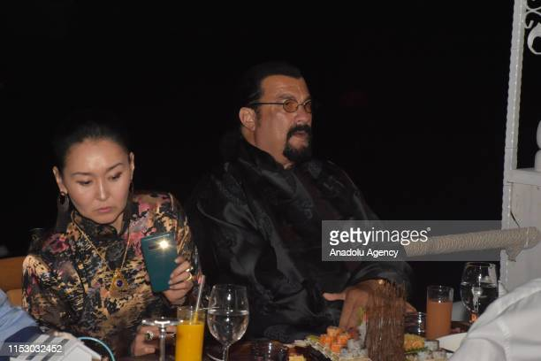 Hollywood actor Steven Seagal and his wife Erdenetuya Seagal attend a dinner following arrival on an invitation from Turkish American Business...