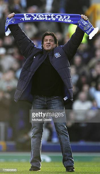 Hollywood Actor Sylvester Stallone salutes the fans with an Everton scarf prior to the start of the Barclays Premiership match between Everton and...