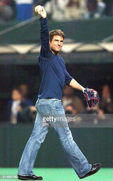 Hollywood actor Tom Cruise acknowledges the audience prior to the Japanese Series baseball championship between Seibu Lions and Chunichi Dragons at...
