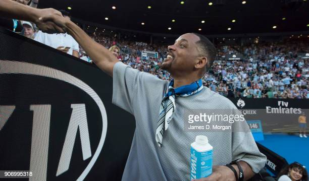 Hollywood actor Will Smith greets Australian fans on Rod Laver Arena as he watches the match between Australia's Nick Kyrgios and France's Jo Wilfred...