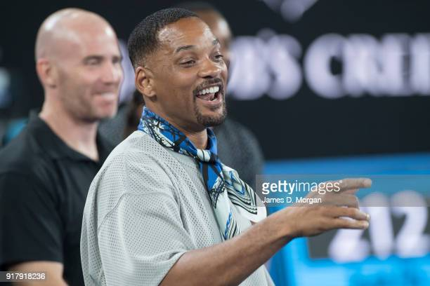 Hollywood actor Will Smith reacts to Australian tennis player Nick Kyrgios being interviewed on TV after his winning match against Jo Wilfred Tsonga...