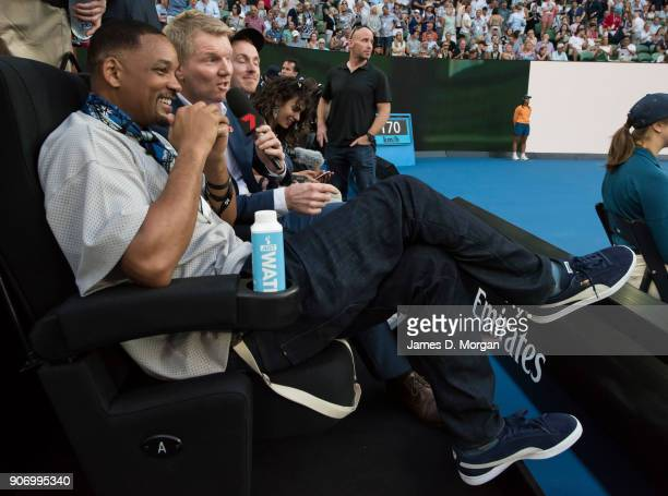 Hollywood actor Will Smith sits on Rod Laver Arena and is interviewed by Jim Courier as he watches the match between Australia's Nick Kyrgios and...