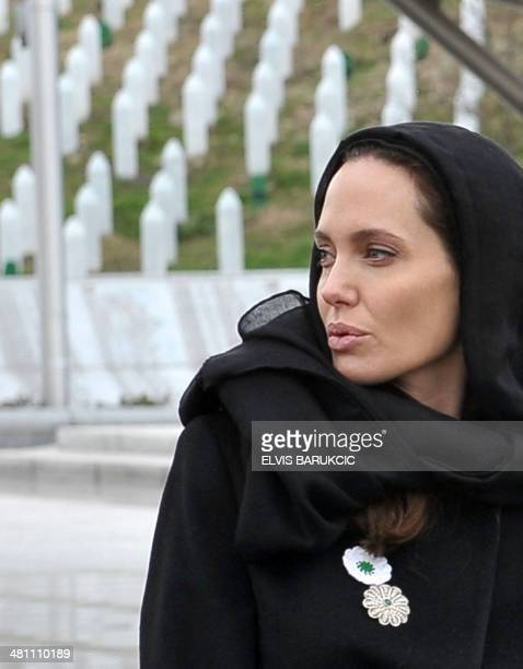 Hollywood actress Angelina Jolie pays her respects at the SrebrenicaPotocari Genocide Memorial cemetery near Srebrenica on March 28 2014 Jolie and...
