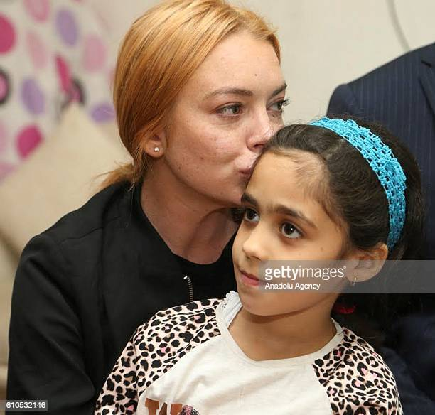 Hollywood actress Lindsay Lohan kisses a Syrian refugee girl at her house after the visit to a hospital built for Syrian refugees at Sultanbeyli...