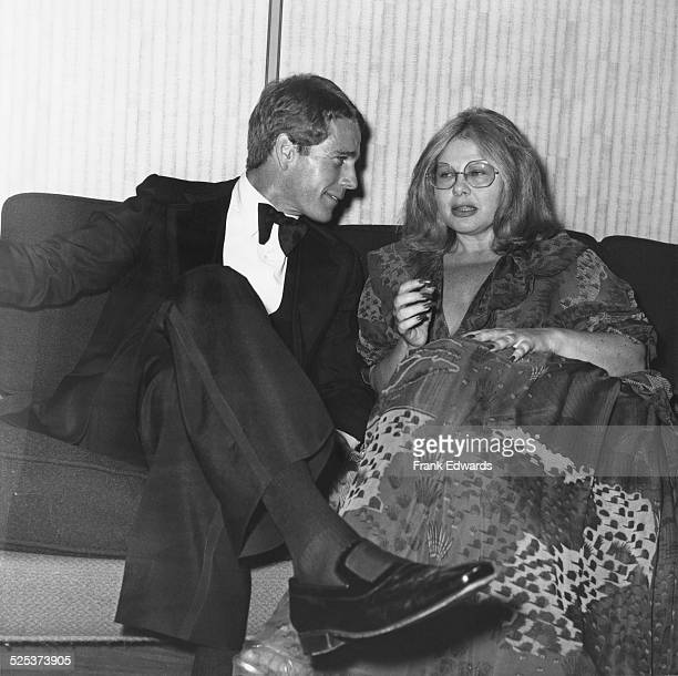Hollywood agent Sue Mengers with American actor Ryan O'Neal at the NATO Awards at the Disneyland Hotel in Anaheim California USA October 1976