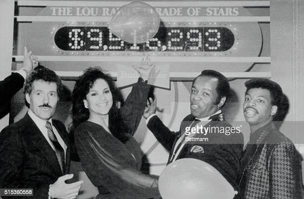 Alex Trebek Jayne Kennedy Lou Rawls and LeVar Burton point with pride to the tote board of the seventh annual Lou Rawls Parade of Stars telethon as...