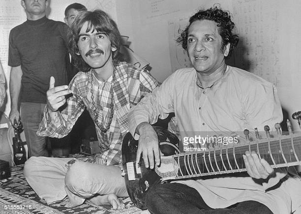 Hollywood: Beatle George Harrison, , listens as Ravi Shanker of India plays the sitar, 8/3, a 25-stringed guitar-like instrument. Harrison said he is...