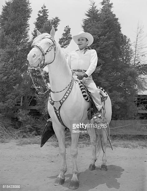 Hollywood: Bob Wills, cowboy band leader, rides on his favorite horse, Punkin, a Palomino for which he paid plenty. Bob's at his Hollywood home.