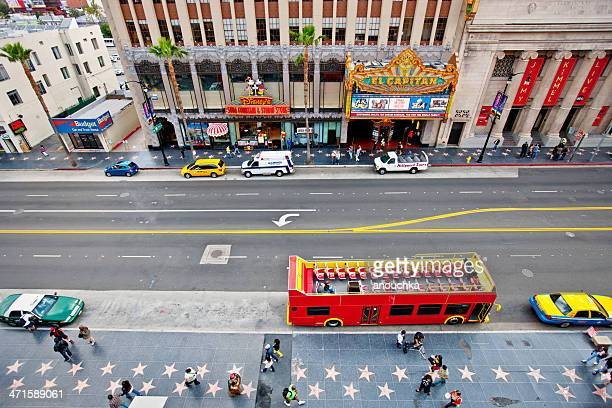 hollywood boulevard, tour bus and el capitan theatre - walk of fame stock pictures, royalty-free photos & images