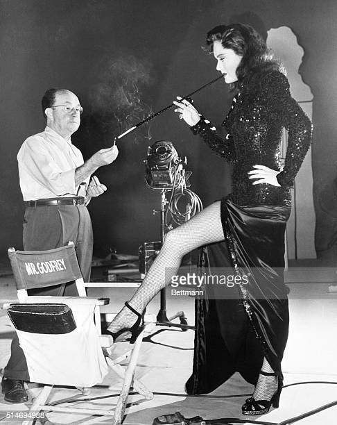 Hollywood CA A femme fatale The girl behind the oversized cigarette holder is Alexis Smith screen actress The long limbed beauty is practicing for...