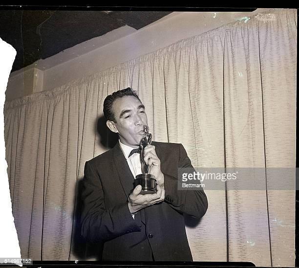 """Hollywood, CA- Actor Anthony Quinn kisses his Oscar March 27th after he was honored as """"Best Supporting Actor"""" for his role in """"Lust for Life""""...."""