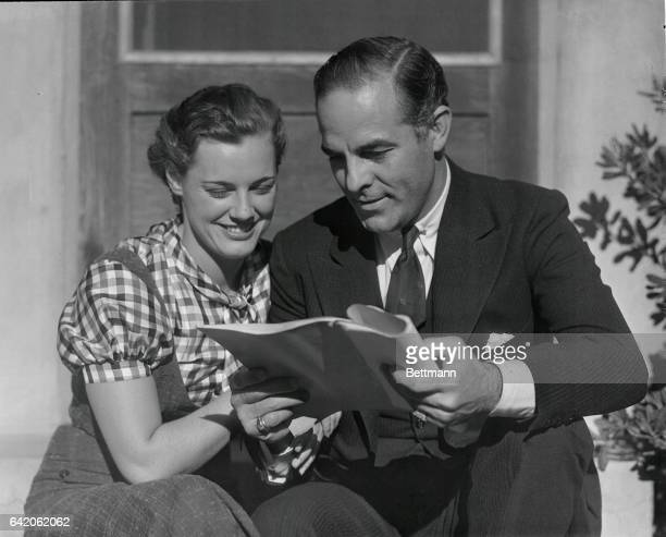 Antonio Moreno popular hero of scores of film dramas goes over the script of swimming star Eleanor Holm's first film Holm won the 100meter back...