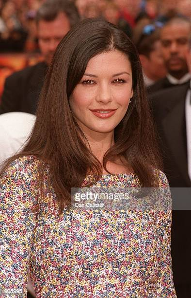 04/13/99 Hollywood CA Catharine Zeta Jones at the Manns Chinese Theatre in Hollywood where Sean Connery had his handprints and footprints moulded in...