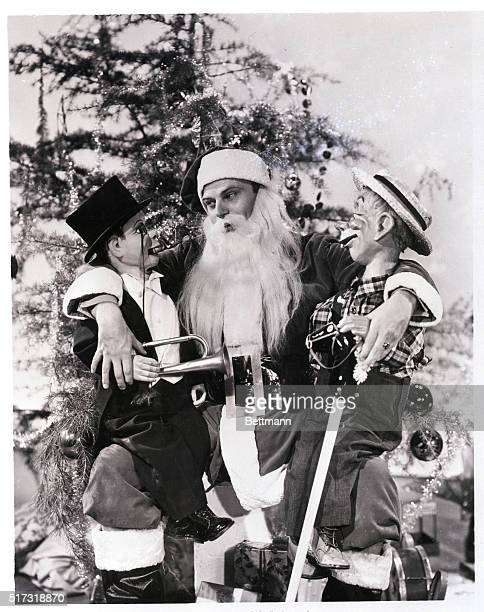Hollywood CA Charlie McCarthy and his timber contemporary Mortimer Snerd strike a Night Before Christmas pose with Edgar Bergen the man who makes 'em...