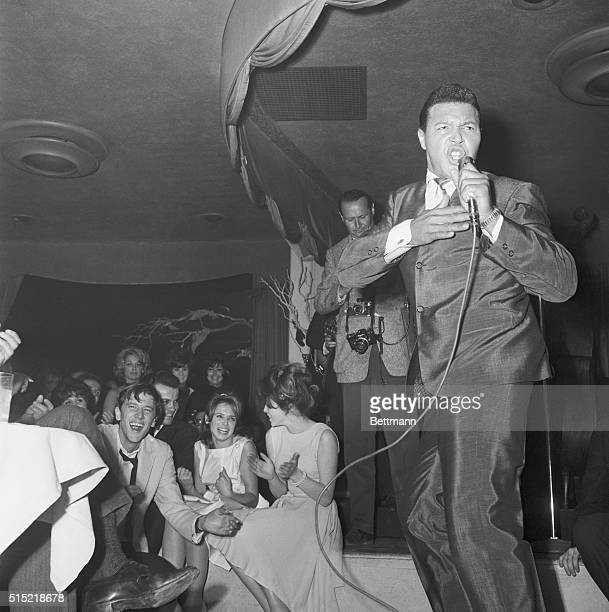Hollywood CA Chubby Checker 'twists' away as he introduces the new dance craze to Hollywood celebrities at The Crescendo a night club on the Sunset...