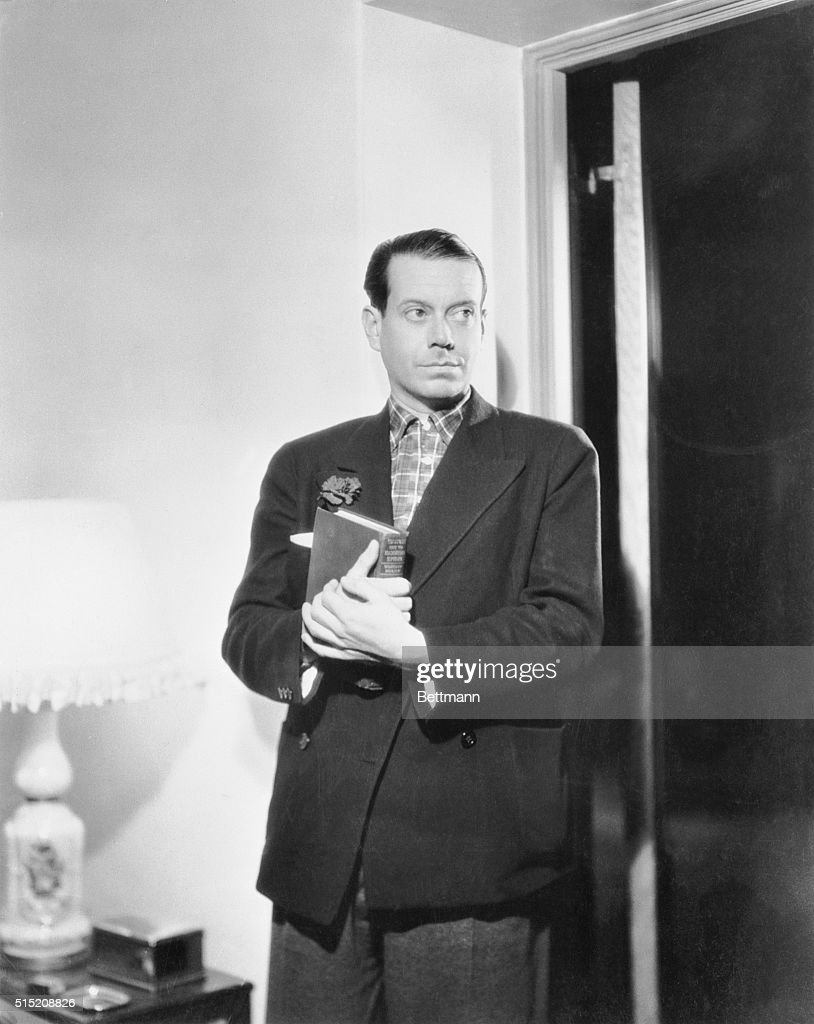 Cole Porter, suave songsmith who is in Hollywood to write lyrics and music for for Eleanor Powell's next spectacular film Rosalie is shown here in an informal moment at his home.