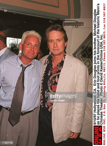 Hollywood CA Eric Douglas joins his brother Michael Douglas as he places his hand and foot prints in the forecourt of the historic Chinese Theater