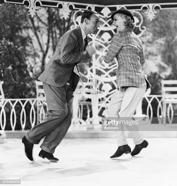 Hollywood CA Fred Astaire and Ginger Rogers famous dancing team of the screen shown in a dizzy whirl of a dance from their latest picture 'Top Hat'...