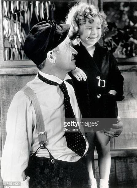 1935 Hollywood CA Great pals in Hollywood ewre Shirley Temple the popular child stars and Will Rogers movie actor and humorist who died in a plane...