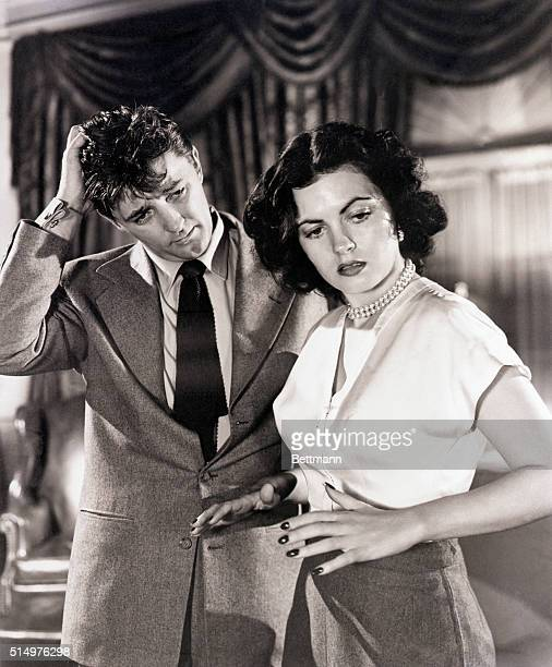 1950 Hollywood CA In Where Danger Lives Faith Domergue emerges as a welltrained star She is shown in a dramatic scene from the picture with Robert...