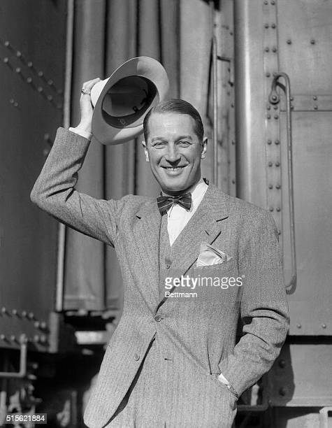 Hollywood, Ca.: Maurice Chevalier wears a panama rather than his familiar straw sailor as he returns to Hollywood to resume his work for Paramount....