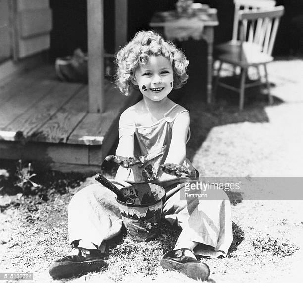 7/9/1934 Hollywood CA Nobody has been slinging mud at elfin Shirley Temple the smudges on her face are the result of a recreation period between...