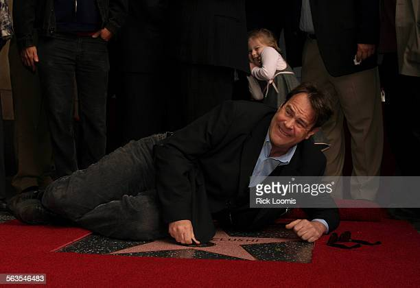 Hollywood Ca––Actor Dan Aykroyd pretends to put a shine on the new star unveiled on Thursday for deceased star John Belushi along the Hollywood Walk...