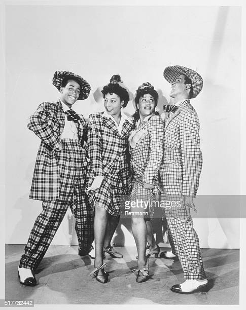 Hollywood Calif Dressed for jive in their super zoot suits are Wynonie Harris Patsy Hunter Neva Peoples and James Burch to be featured in Republic...