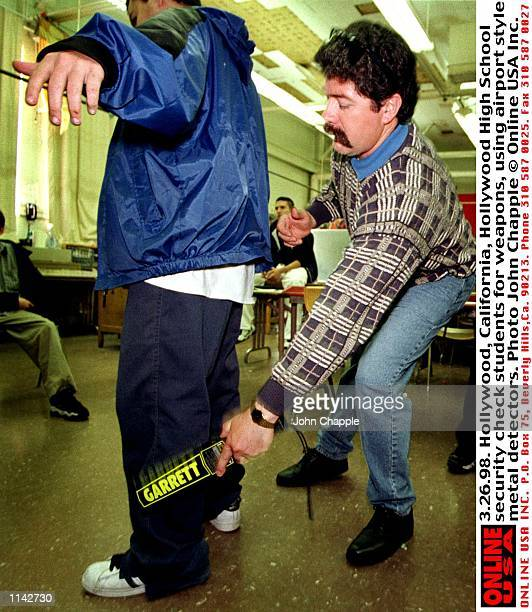 32698 Hollywood California Hollywood High School security check students for weapons using airport style metal detectors